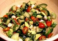 2 cucumbers- cut up, 1 pint cherry or grape tomatoes (about 30), 2 tablespoons chopped fresh basil, 1 cup fresh mozzarella, 1 avocado, 1 tablespoon extra virgin olive oil, 2 tablespoons balsamic vinegar, 1 teaspoon garlic powder, Salt and pepper to taste