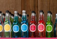 blue, bottle labels, green, red, whimsical-bright, yellow, over, rainbow, reception, somewhere, wedding