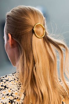 Celine Spring 2015 accessorized models' hair with gold barrettes. All the details on the beauty look here: