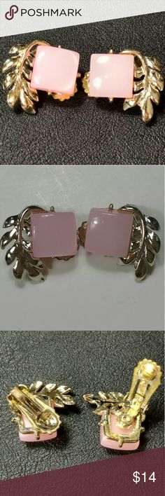 Vintage pink lucite w silver toned leafs earrings These beautiful clip on earrings feature a pink lucite plastic square set on silver toned setting with silver toned leafs.  In excellent vintage condition.  As with all clip on earrings, these can be worn on the ears.  But they can be clipped to a variety of other things should you wish.  For example: a hairband, purse straps, button holes, dress straps, or shoes Vintage Jewelry Earrings