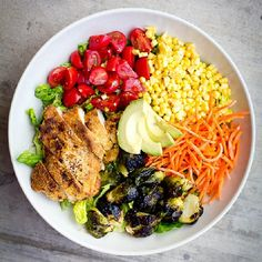 This Rainbow Salad with Balsamic Roasted Brussels & Paleo Almond Crusted Chicken is delicious, budget friendly, and will last all week!