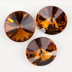 Eureka Crystal Beads - 1122 12mm Rivoli SMOKED TOPAZ Swarovski Crystal Stones (4 pcs), $3.30 (http://www.eurekacrystalbeads.com/1122-12mm-rivoli-smoked-topaz-swarovski-crystal-stones-4-pcs/)