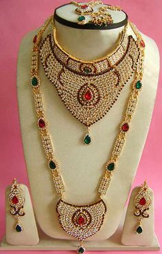 #Red, #Green and White Stone Studded #Necklace Set @ $128.84 | Shop @ http://www.utsavfashion.com/store/item.aspx?icode=jnc2390