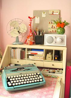 Pink pink pink..my friend Sandy would love this room.  We call Sandy, Pinky.  By the way, where did old typewriters go?  I would love to have one.