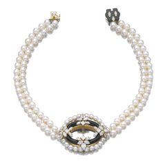 ONYX, CULTURED PEARL, AND DIAMOND NECKLACE, CARTIER The circular hoop of onyx embellished with marquise-, pear-shaped and carré-cut diamonds, set within a surround of cultured pearl beads to a double strand cultured pearl necklace, the clasp set with onyx and marquise-shaped diamonds, signed Cartier Paris and numbered, French assay and maker's marks.