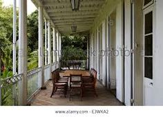 Stock Photo - Table and chairs on veranda of La Maison Creole a French colonial house also known as Eureka or house of 109 doors in Moka French Creole, Home Library Design, French Colonial, Interior Decorating, Interior Design, Table And Chairs, Patio, Doors, Stock Photos