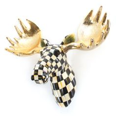 Around holiday-time, our hand-painted Courtly Check® Small Moose Head demands to be the jaunty centerpiece of any and all household wreaths. Off-season, his leaf-green ears, sun-gold antlers, and placid nonchalance transform him into the beau of the hall, mantelpiece, or any other space that calls for checkered charm and whimsy.