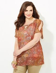 Our flowing top beautifully combines tribal patterns with modern shimmer. Open-shoulder detail make this top fashion-forward and perfect for the warm summer months. Scoop neckline with keyhole detail. Short sleeves. Side slits at hem. Catherines tops are perfectly proportioned for the plus size woman. catherines.com