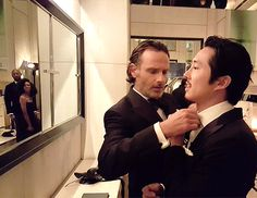 ricky-grimes: Andrew Lincoln helping Steven Yeun prep for the #TWDFanPremiere (x)