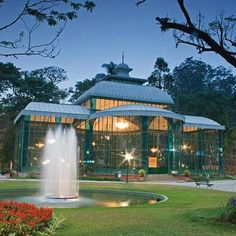 This is the Palácio de Cristal Petropolis in Rio de Janeiro.  This modern mansion looks gorgeous.  The architecture is very unique and uncommon.  To me it looks like the house is made of all glass and allows the residents to see all around them no matter where they are.  They can enjoy the nature in the comfort of air conditioning.
