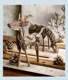 "Driftwood Deer. Natural found driftwood are selected and assembled by hand to create our serene grazing and standing deer. Standing is 15"" H. Grazing is 17"" L"