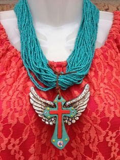 Clay cross pendant with wings and bling, turquoise MULTI strand necklace ... Shop at Facebook.com/Lety.Rangel