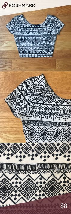 """Forever 21 black and white crop top About: • brand: Forever 21 • size: medium • Aztec styled crop top • black and white in color   Measurements: • bust: 31"""" • length: 15""""  Flaws: • tiny red mark on right shoulder as seen in pictures Forever 21 Tops Crop Tops"""
