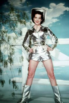 Natalie Wood sure did know how to make an entrance.. the silver suit didn't hurt either!