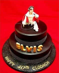Elvis cake-white icing instead of chocolate. LOVE the bling!