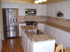 A sink was placed on an island to create an efficient work area in this small ki. A sink was placed on an island to create an efficient work area in this small kitchen by McClurg. Kitchen Island With Sink And Dishwasher, Small Dishwasher, Narrow Kitchen Island, Sink In Island, White Kitchen Island, White Kitchen Cabinets, Kitchen Islands, Kitchen Sinks, Small Sink