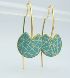 Contemporary polymer clay earrings with a criss cross design and 14k gold filled wire. $35.00, via Etsy. Betsy Baker