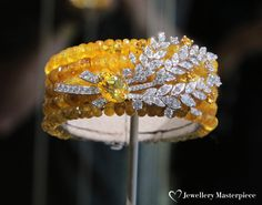 Moisson d'Or bracelet from Haute Joaillerie Les Blés de Chanel collection in 18K white and yellow gold set with a 5.1-carat marquise-cut yellow sapphire, diamonds, yellow sapphires and 283 yellow sapphire beads for a total weight of 211.5 carats.