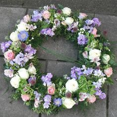 Beautiful traditional open Wreath of whites, pinks and lilacs, with Bear Grass. Funeral Flower Arrangements, Funeral Flowers, Florist London, Fresh Wreath, Funeral Tributes, Sympathy Flowers, Easter Wreaths, How To Make Wreaths, Floral Design