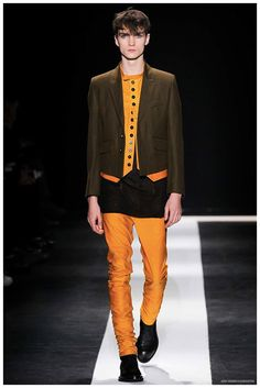 Designer Sébastien Meunier used his sophomore outing for Ann Demeulemeester to present a man with a harder edge. Gravitating away from soft knitwear, the uniform was more about tailored leather with a slim silhouette. Layered with the brand's signature shirts and waistcoats, jackets and coats came in a variety of lengths and featured removable u-shaped attachments. Adding a splash of color to the somber lineup, green, ...