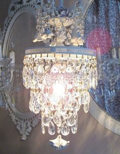 All Things Shabby and Beautiful ~ shabby chic chandelier. I totally want a small chandelier in my walk in closet...the hunt is on!