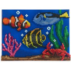 It's colorful here on the tropical reef in this snapshot view of underwater life . It's colorful here on the tropical reef in this snapshot view of underwater life. Design by Kyle Perler Bead Designs, Easy Perler Bead Patterns, Hama Beads Design, Beading Patterns Free, Perler Beads, Perler Bead Art, Hama Beads Animals, Beaded Animals, Plastic Canvas Ornaments