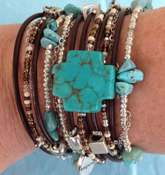 Boho Chic Brown Leather Wrap Bracelet with Turquoise Cross and Beaded Accentss.  Bracelets consists of 5 seperate unique strands.  Please see listing for details.  by DesignsbyNoa, $38.00
