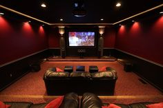 """Scott A. Pope's Man Cave entertainment room the ultimate den of tech delights for the sheer scope of his options. Part home office, part media library and also home theater with 92"""" screen, Sirpopealot's Man Cave is about going all out with enviable storage and display options."""