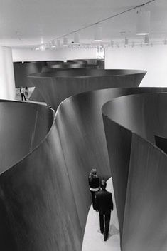 Installation view of Richard Serra Sculpture: Forty Years in the second-floor Contemporary Galleries at The Museum of Modern Art. Shown: Sequence. 2006. Weatherproof steel. Collection the artist. Torqued Torus Inversion. 2006. Weatherproof steel. Collection the artist. Band. 2006. Weatherproof steel. Los Angeles County Museum of Art. Gift of Eli and Edythe Broad. (c) 2007 Richard Serra / Artists Rights Society (ARS), New York Photo: Lorenz Kienzle.