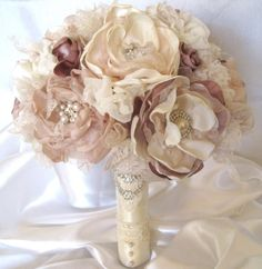 Wedding Bouquet Vintage Inspired Fabric Flower and Brooch Bouquet in  Ivory, Champagne and Dusty Rose with Pearls, Rhinestones and Lace. $275.00, via Etsy.