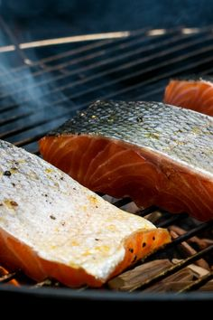 NYT Cooking: This grilled and smoked salmon recipe by the food writer Betty Fussell calls for curing the fish for several hours with salt, brown sugar and spices before smoking it over indirect heat on your grill. While the fatty fish absorbs the smoke beautifully, the fish can also be successfully cooked in a grill pan, or under the broiler. The salt and sugar cure, laced with%2...