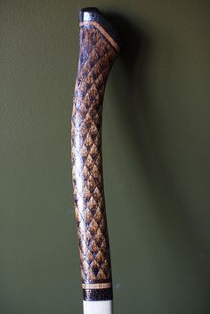 "I think its an axe handle but it would make a sleek handle for an ""elvish"" style blade"