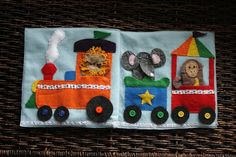 The Quiet Book Blog--such a cute  circus/ zoo train page. Love this