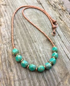 Beautiful turquoise blue / green Czech glass beads with tiny copper spacers and copper colored Czech glass seed beads. 18 in length with an antiqued copper lobster claw clasp. Length may be adjusted upon request.