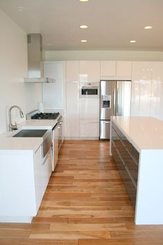 IKEA Kitchen. Great amount of storage in kitchen island! - tall cupboards for bar area