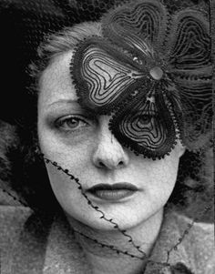 1937 cover of LIFE magazine, a model wears an intricate, romantic veiled hat designed by Lilly Daché. Photo by Alfred Eisenstaedt.