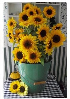 Sunflower arrangement in green bucket