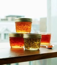Christmas Pepper Jelly - This recipe makes a fiery golden, translucent jelly with colourful suspended fruit and vegetables. Serve it with cheese or melt it onto grilled or sautéed dishes to add sparkling flavour highlights