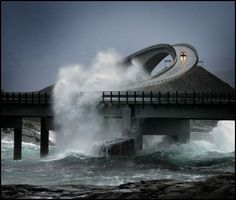 The Atlantic Road in Norway.  Built high enough for the waves to crash through. This would freak me out!!