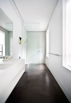 Polished concrete, darker - closer to the bathroom floor.