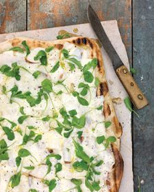 Grilled Pizza with Fontina and Arugula:   2 tablespoons extra-virgin olive oil, plus more for drizzling  2 pounds store-bought pizza dough (thawed if frozen)  1 pound fontina cheese, thinly sliced or grated  Sea salt and freshly ground pepper  1/2 cup baby arugula