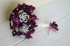 Plum brooch bouquet and boutonniere.