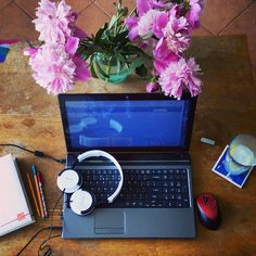 Peonies in front of me a gin and tonic in my hand some pleasant noise in my ears for once... I could do this all day.  . . . . . #blogging #lifestyle #lifestyleblogger #bbloggers #peonies #laptop #colourful #myworkplace #whereiwrite #whereiblog #pinkpeonies