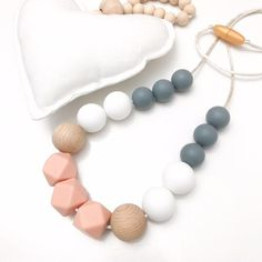 POPPY Silicone Necklace from ONE.CHEW.THREE. Handmade with nontoxic, food grade silicone and naturally antibacterial beech wood beads.