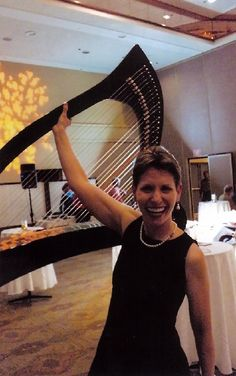 Lifting a carbon fiber harp with one hand at CD release party at Harvey's Resort, Stateline, Nevada
