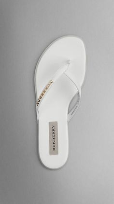 Burberry, Patent London Leather Flip Flops in White, $300