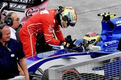 Sebastian Vettel thanks Pascal Wehrlein, after giving him a drive back to the pits after the race today