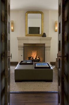 This beautiful fireplace features larger-than-average firebricks in a herringbone pattern and a Texas limestone mantel.