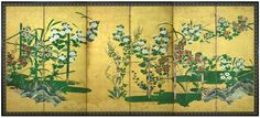 """A pair of six-fold paper screens painted in ink and colour on a gold ground with red and white kiku (chrysanthemum), autumn flowers and a bamboo trellis next to rocks; a body of deep blue water can be glimpsed at the edge of the right hand screen. The golden clouds and white kiku are rendered in moriage (raised design). Paper, ink, colour. Dimensions: H. 68"""" x W. 151½"""" (172.5cm x 384.5cm), Japan, 17th century, Momoyama period."""