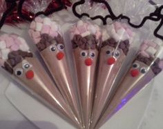 christmas eve box fillers.             candy bags. coca mix (hot chocolate). Chocolate chips.  And marshmallows. Tied up with pipe cleaner and googly eyes.